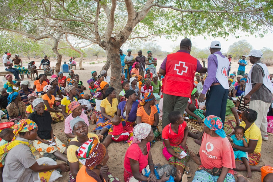 <p>Women in the Funhalouro district of Imhambane province in Mozambique await a food distribution by the Mozambican Red Cross.</p>