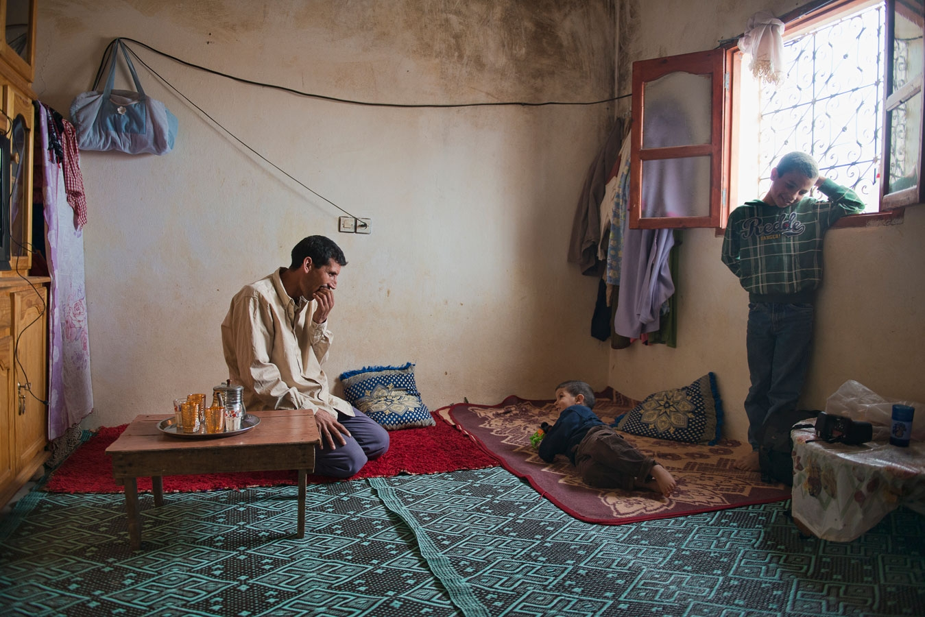 <p>Lahcen, one of Morroco's many agricultural laborers, at home with his children. He earns €6 for a hard day's work</p>