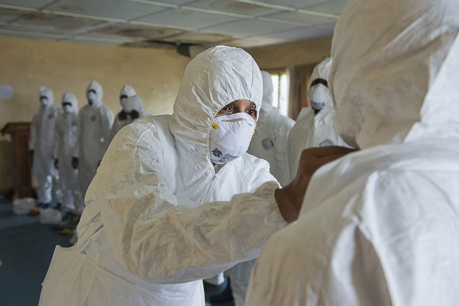 <p>A Red Cross training session for new burial team recruits during the 2014 Ebola outbreak</p>