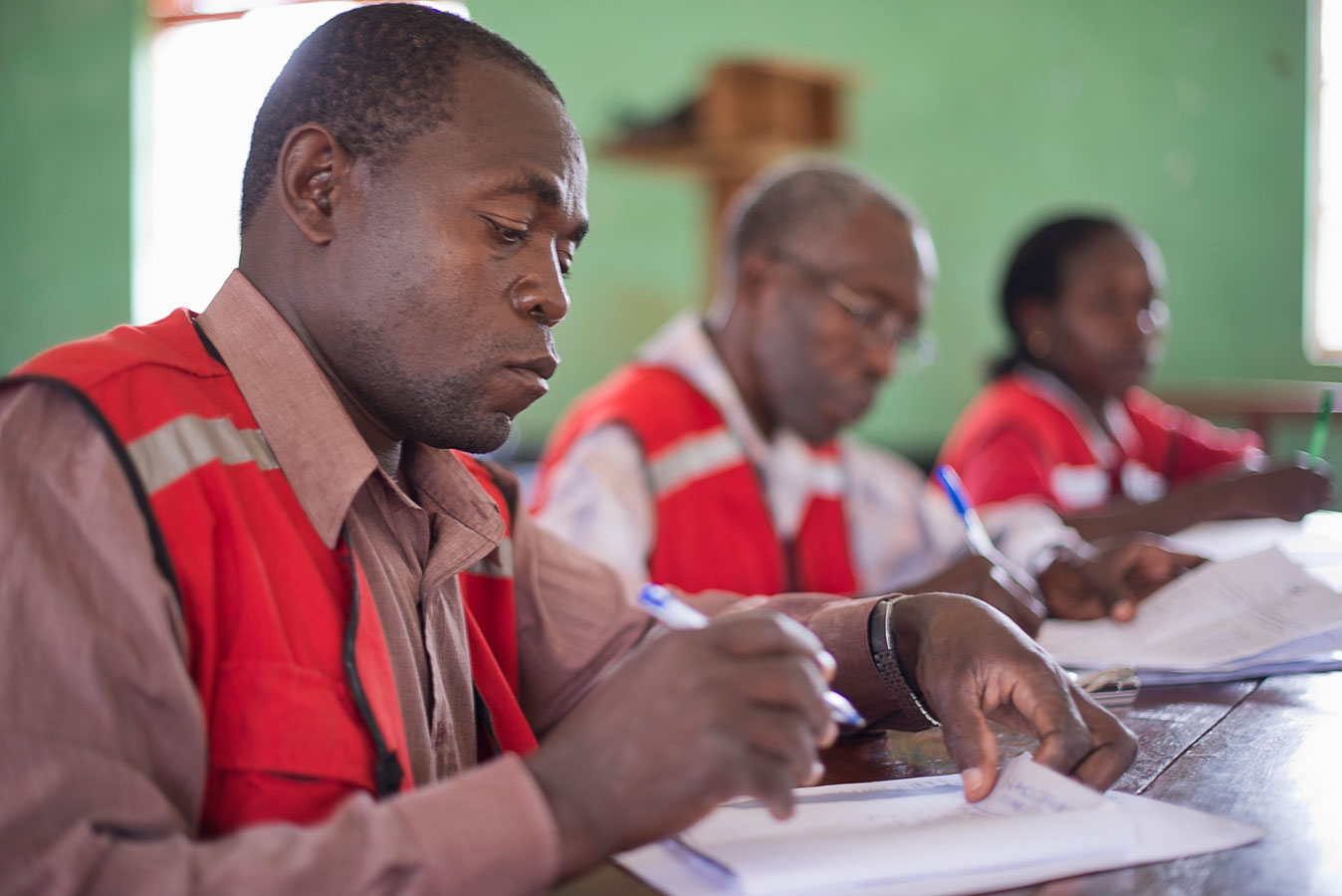 <p>Red Cross staff meeting to discuss how to help contain an outbreak of Ebola in the  Luweero district of Central Uganda</p>